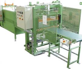 Balící stroje - příklady balících strojů-Stroje pro balení kobercových desek FSP 1000